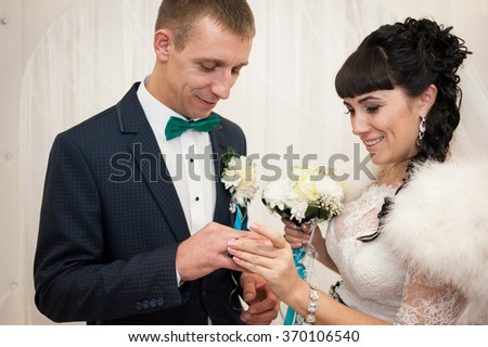 The newlyweds exchanged gold rings at a wedding ceremony