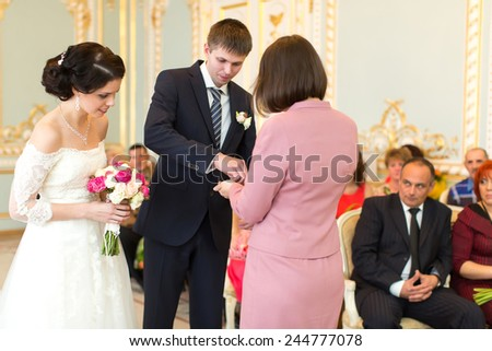 The newlyweds exchanged rings. Solemn registration of marriage.  - stock photo