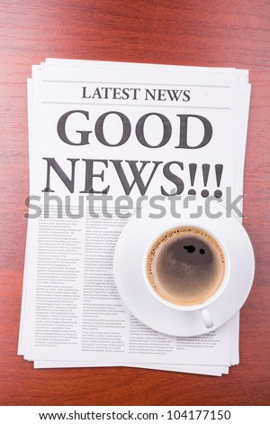 The newspaper LATEST NEWS with the headline GOOD NEWS  and coffee - stock photo