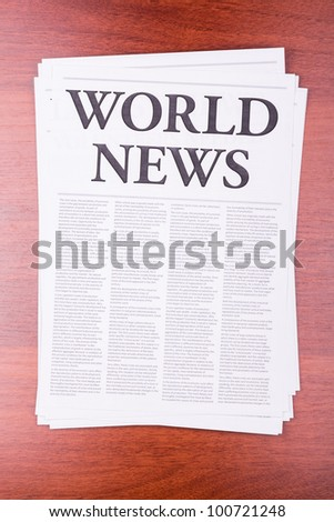 The newspaper WORLD NEWS on table - stock photo