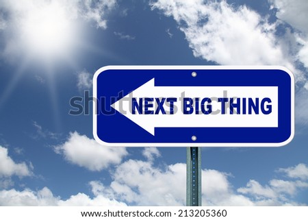 The next big thing road sign against a beautiful blue background - stock photo