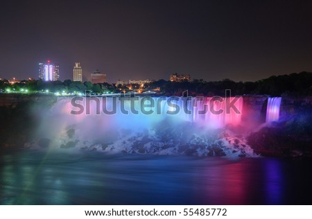 The Niagara Falls are voluminous waterfalls on the Niagara River, straddling the international border between the Canadian province of Ontario and the U.S. state of New York. - stock photo