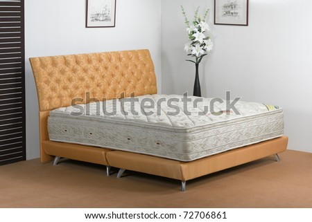 The nice bedroom atmosphere and the softness of mattress spring makes you have a nice dream - stock photo