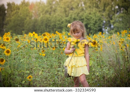 the nice girl in the field of sunflowers  - stock photo