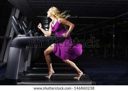 The nice women in beautiful dress indoors the gym - stock photo