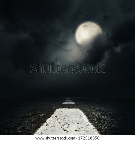 the night road with the full moon - stock photo