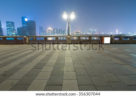 The night scenic of Guangzhou, a bridge with colorful neon light over the Pearl River.