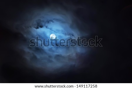 The night sky, moon in the clouds - stock photo