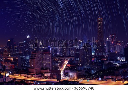 The night sky , the stars and the Tallest building in the city.