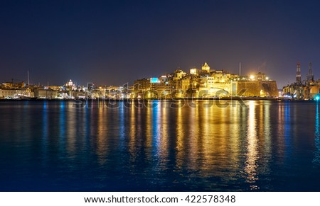 The night view of Senglea peninsula and Dahla tad-Dockyard bay over the Grand Harbour from Valletta, Malta