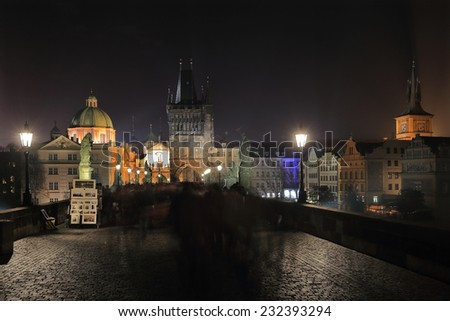 The night View on bright Prague Old Town with the Charles Bridge and its Bridge Tower and Sculptures, Czech Republic - stock photo