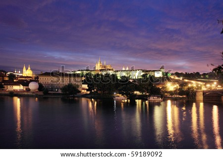 The night View on bright Prague with gothic Castle