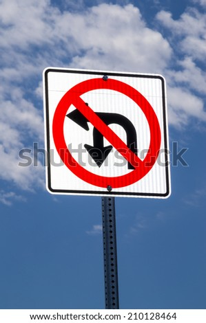 "The ""No U-turn or left turn"" sign."