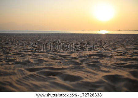 the nobody sand background far far away from sea , under sunset - stock photo