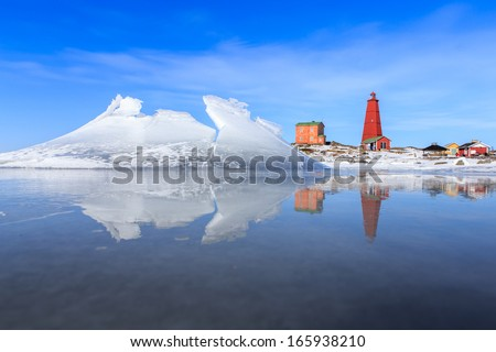 The nordic spring at a lighthouse.  - stock photo
