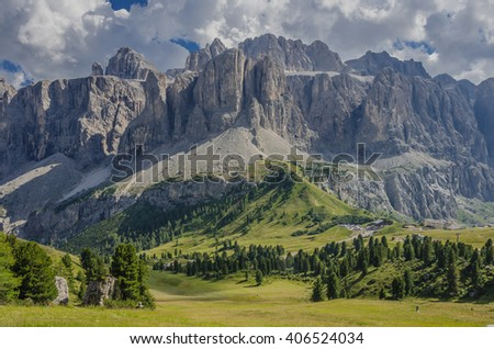 The north face of Sella mountain group as seen from Passo Cir (Cir pass) descent to Passo Gardena (Gardena pass), Selva village, Val Gardena (Gardena valley), Dolomites, Bolzano, South Tyrol, Italy