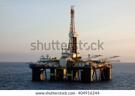 THE NORTH SEA, OFFSHORE ABERDEEN, SCOTLAND - 10 SEPTEMBER 2015. The semi-submersible drilling rig Transocean Sedco 704 seen in the early morning light.