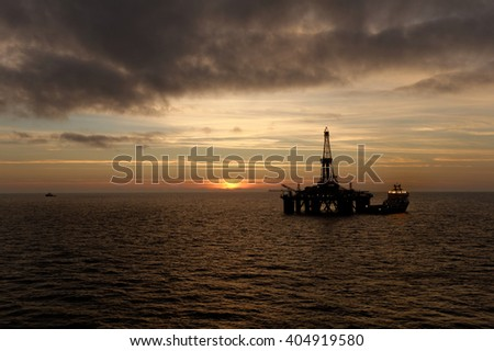 THE NORTH SEA, OFFSHORE ABERDEEN, SCOTLAND - 10 SEPTEMBER 2015. The semi-submersible drilling rig Transocean Sedco 704 seen at sunset.