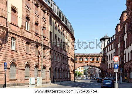 The north wing of the Old Town Hall with the Bridge of Sighs on Braubachstrasse street in Frankfurt am Main, Germany. The entire building complex consists of nine houses, encircling six courtyards. - stock photo