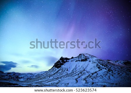 The Northern Light aurora over at snow Mountain Iceland
