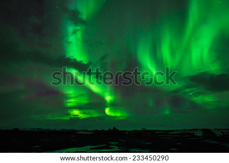 The Northern Lights  as seen from Western Iceland  - stock photo