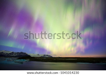 The Northern lights (Aurora borealis) over the Jokulsarlon glacier lagoon (glacial lake) on the edge of Vatnajokull National Park in Iceland.