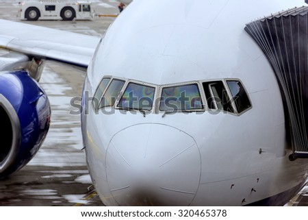 the nose of the aircraft is a close-up of passengers landing at the airport - stock photo