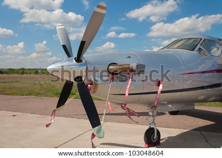 The nose of the turboprop aircraft, a brilliant cook propeller - stock photo