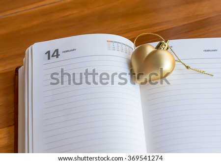 The Note for 14 february wit gold heart - stock photo