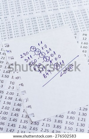 The note with the lose selection of the winning codes on bookmakers