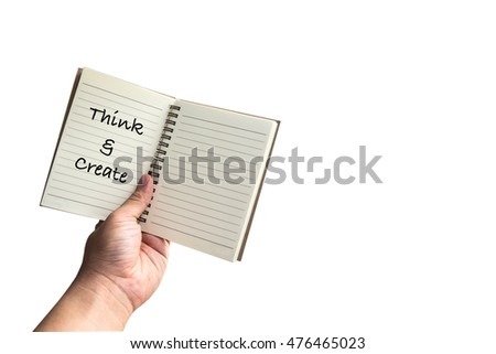 "The notebook with hand writing ""Think and Create"" on hand"