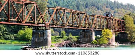 The now abandoned warren through truss swing span bridge over the Skagit River in Skagit County, Washington, USA. - stock photo