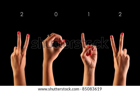 The number 2012 are shown via fingers in creative New Year greeting card