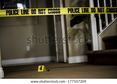 The number 4 crime scene marker on the floor of a house.