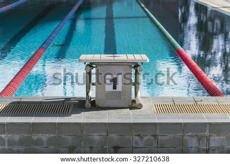 The number 1 diving platform in a swimming pool competition - stock photo
