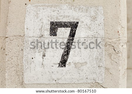 The number seven painted on a car park wall - stock photo