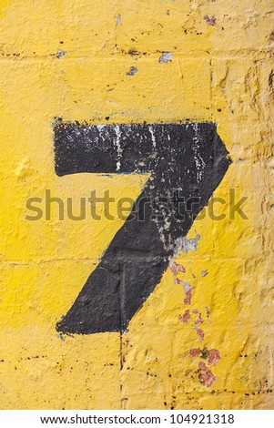 The number seven painted on a carpark wall - stock photo