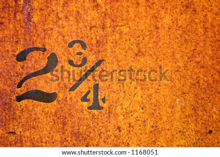 The number two and three quarters painted on the side of on old train car. - stock photo
