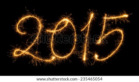The numbers 2015 set in sparkly handwriting design on black background. - stock photo