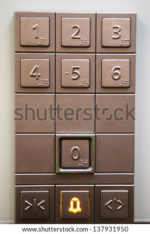 The numeric key pad inside an elevator - stock photo