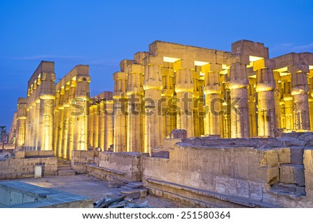 The numerous columns of the Luxor Temple in the bright evening illumination, Egypt. - stock photo