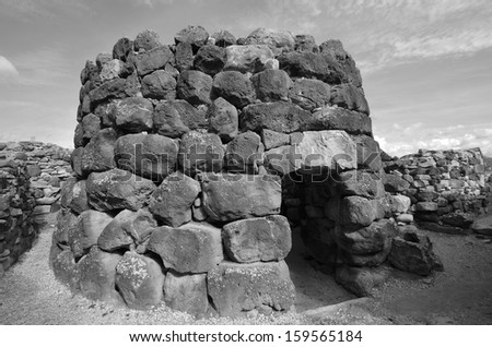 The nuraghe (nuraghi, nuraghes) is ancient megalithic edifice, the symbol of Sardinia and the Nuragic civilization. - stock photo