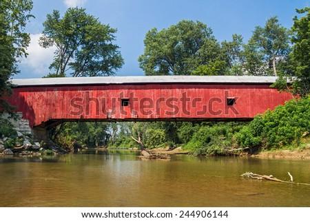 The Oakalla Covered Bridge crosses Big Walnut Creek in rural Putnam County, Indiana. - stock photo
