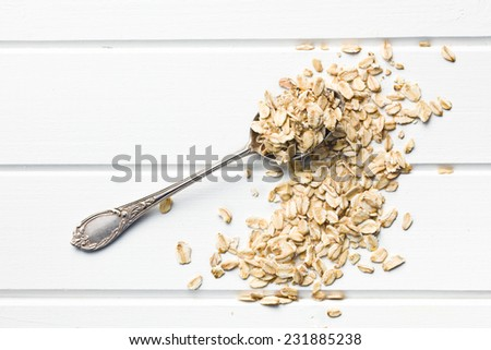 the oat flakes in spoon - stock photo