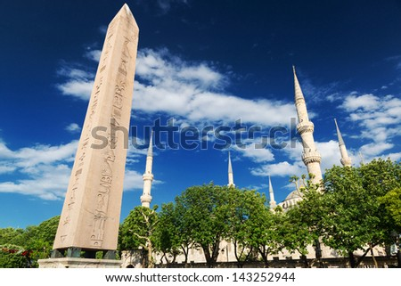 The Obelisk of Theodosius and minarets of the Blue Mosque in Istanbul, Turkey. This is the Ancient Egyptian obelisk of Pharaoh Tutmoses III re-erected by the Roman emperor Theodosius I in the 4th cent - stock photo