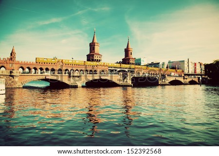 The Oberbaum Bridge, German Oberbaumbrucke and River Spree in Berlin, Germany. Retro, vintage version - stock photo