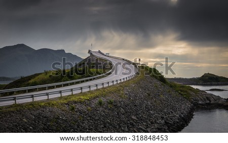 The Ocean road, Norway, during evening, with a cloudy sky.