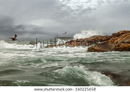 The ocean westbound of Portugal at the water mouth of the River Douro in Porto in autumn - stock photo