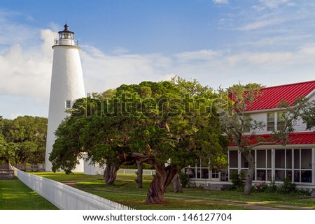 The Ocracoke Lighthouse and Keeper's Dwelling on Ocracoke Island of North Carolina's Outer Banks. - stock photo