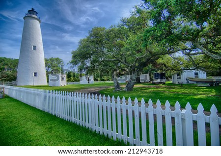 The Ocracoke Lighthouse and Keeper's Dwelling on Ocracoke Island of North Carolina's Outer Banks - stock photo